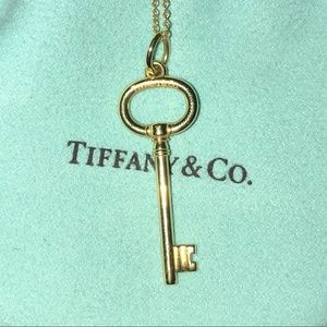 Tiffany and Co 18k mini oval key pendant